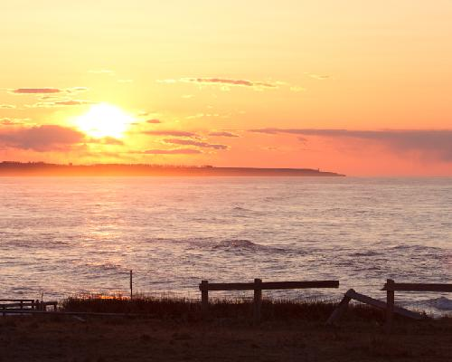 The Sun begins to set on Cavendish Beach.