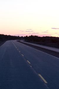 A road awaits the next vehicle while enjoying the sunset in the National Park on PEI